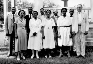 A group of African American Home Demonstration Agents in 1933 standing near a gazebo.