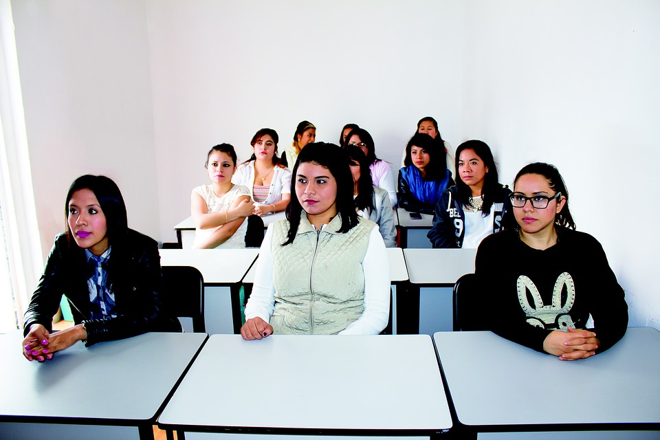 A small group of students in a college classroom.