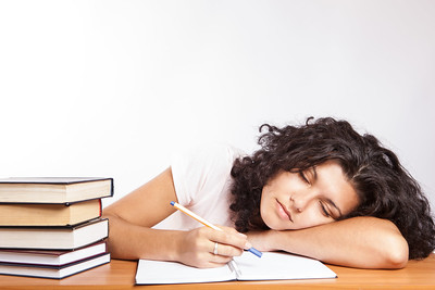 Women napping while studying.