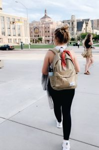 Masen walking away from camera across the square on UW-Madison campus in September 2019